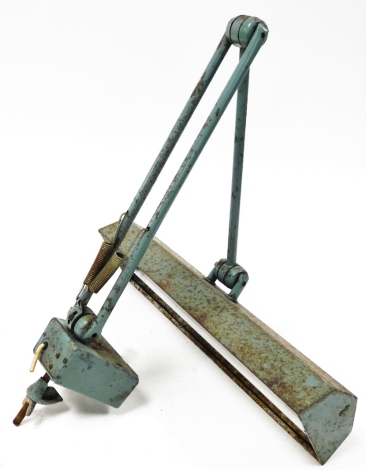 An industrial desk mountable angle poise lamp, with a rectangular lamp head on two arch support, approx 80cm high when fully extended, 44cm wide.