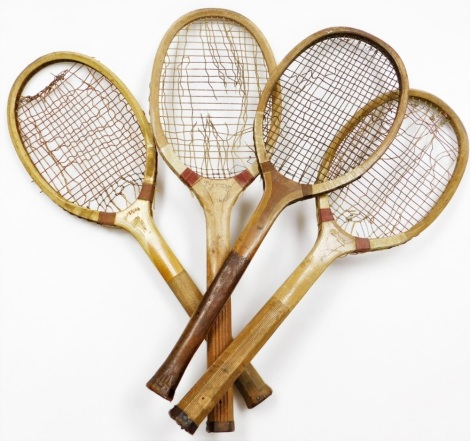Four tennis rackets, to include one stamped FA Davis Ltd Brooks Market London, another unmarked, another marked CAL and another stamped AG Spalding & Bros Brighton. (4)