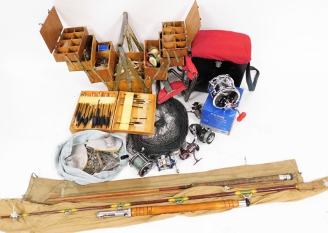 A group of fishing reels, boxes and rods, to include a Penn reels Penn Senator reel, landing net, two rods unmarked, fishing seats, various flies, hooks, etc. (a quantity)
