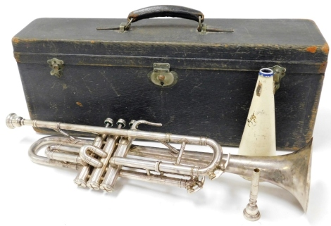 A Selmer Rolls Diplomat silver coloured cased trumpet, with two mouth pieces.