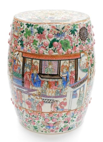 A Chinese porcelain garden seat, of barrel shape profusely decorated with court scenes on a floral and butterfly background in famille rose palette, 19th/20thC, 47cm high
