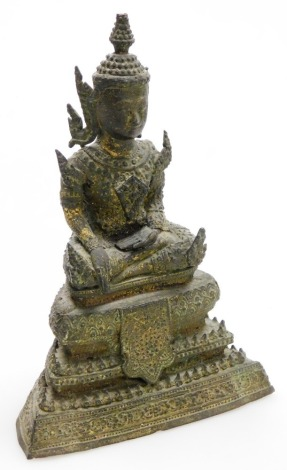 A Thai bronze figure of a seated Buddha, on a Tiered base, 19cm high.