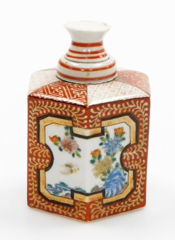A Japanese porcelain hexagonal bottle and cover, decorated predominantly in orange with panels of flowers and birds, six character mark to underside, Meiji period, 13cm high.