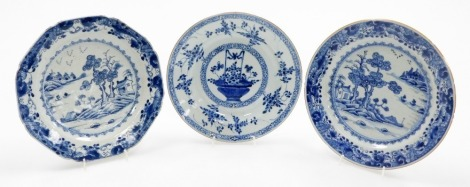 Three Chinese 18thC blue and white plates, one of octagonal form, with outbuildings and trees, 22cm wide, another, circular of similar design, 23cm wide, and a floral basket example, 21cm wide. (3)