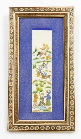 A painted Middle Eastern ivory panel, with figures of warriors on horseback, in a later mosaic frame, 21cm x 5cm.