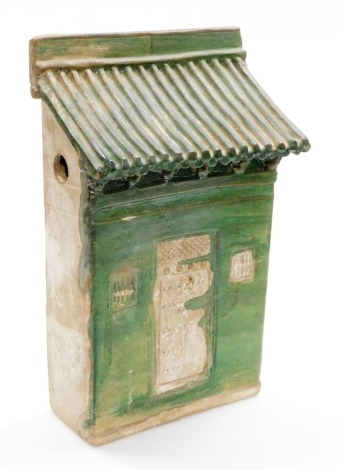 A Chinese Tang style slab pottery model of a house front, with green glaze, probably of the period, 41cm high, 26.5cm wide.