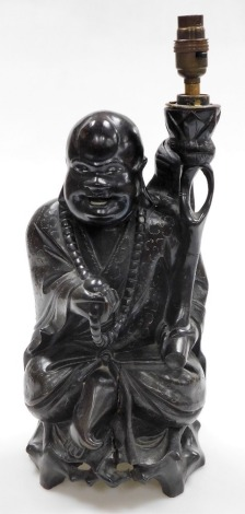 A Chinese teak figure of seated Putai with beads and staff, the body profusely inlaid with silver wire designs, converted to a table lamp, 46cm high. (AF)