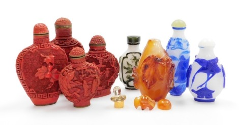 Three Chinese overlay glass snuff bottles and others, including four moulded composite bottles, and an agate bottle carved with fruiting peach. (8)