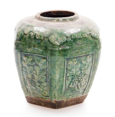 A Chinese green glazed hexagonal pottery jar, with rectangular low relief floral panels, 19thC, 16cm high.