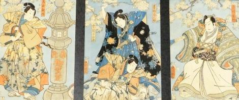A framed Japanese woodblock triptych by Utagawa Kunisada, a scene from the kabuki play Shiranui Monogatari depicting Aoyagi Harunosuke waving a blossom cherry branch as he stand over the samurai Yukioka Fuyujiro, circa 1853, each 33cm x 23cm.