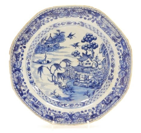 A Chinese blue and white octagonal plate, decorated with the Willow pattern within butterfly and diaper borders, 18thC, 23cm wide.