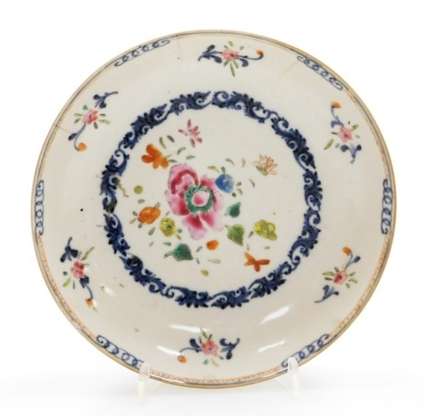 A Chinese porcelain plate, decorated with a central roundel of flowers with a scrolling underglaze blue border, 19thC, 16cm diameter.