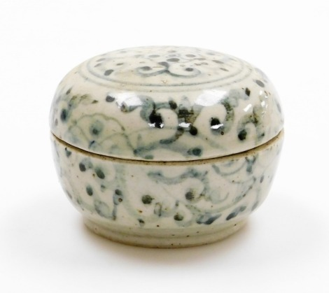 A Chinese pottery covered box, decorated in underglaze blue with scrolling designs, Ming dynasty, 9cm wide.
