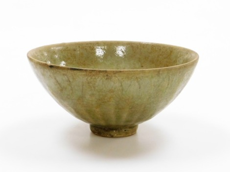 A Chinese longquan celadon bowl with lappet design to exterior, possibly Yuan dynasty, 15cm wide.