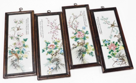 A set of four late 19thC Chinese porcelain panels, each decorated with birds and flowers, in stained mahogany frames, 46cm x 20cm. (4)