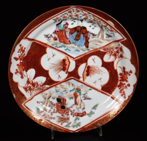 A 19thC Japanese Hirado plate, decorated in overglaze colours with panels of figures and flowers with gilt highlights, predominately in orange, the underside marked Mikawachi seizo, 18cm diameter.