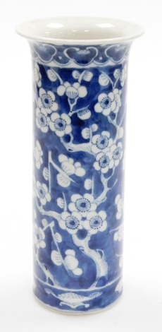 A Chinese porcelain cylinder vase, decorated in blue and white with prunus branches, four character mark Kangxi mark to underside, 19thC, 25cm high, 11cm diameter.