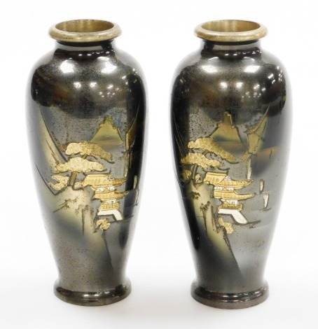 A pair of Japanese bronze vases, each with etched designs of pavilions in mountainous landscape, silvered and gilt highlights, the bases stamped Japan, 20thC, 15cm high. (2)