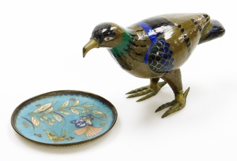A Chinese cloisonne model of a hawk, with brass legs and beak coloured in brown, black, blue and green, modern, 14cm high, 20cm wide; together with a Japanese cloisonne dish, the front with butterfly and flowers on a blue ground, the reverse with a fruiti