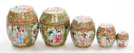 A graduated set of 19thC Chinese Canton porcelain jars and covers, decorated with panels of figures, birds and flora, from 10cm high down to 4cm high.