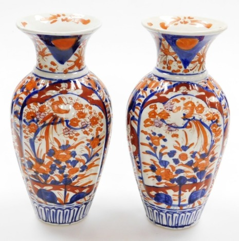 A pair of Japanese Imari baluster vases, decorated with panels of birds and flowers, 20thC, 31cm high.