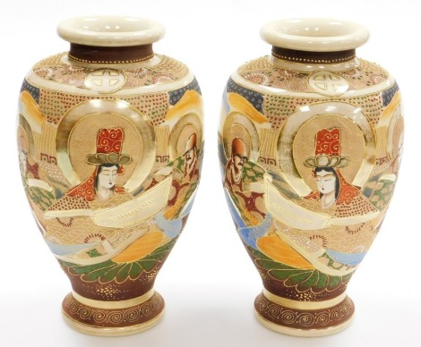 A pair of 20thC Japanese Satsuma baluster vases, decorated with deities in a mountainous landscape, signed to base, 30cm high.