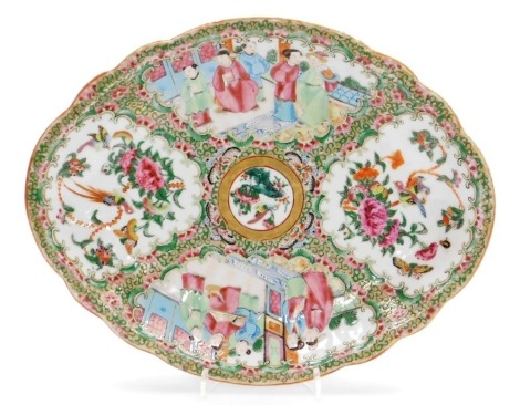 A 19thC Chinese Canton porcelain oval dish, decorated with opposing panels of court scenes and floral designs, 27cm x 22cm.