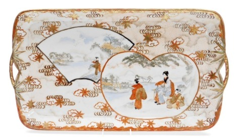 A Japanese Kutani porcelain two handled tray, with asymmetrical heart and fan shaped scenes painted with figures, bamboo style handles, Meiji period, 50cm x 30cm.