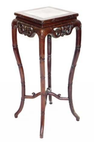 A late 19thC Chinese hardwood plant stand, the square top with marble inset, the splayed legs carved in imitation of bamboo, 92cm high, 36cm wide, 36 deep.