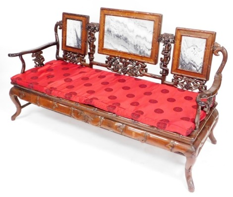 A Chinese hardwood three seater sofa, carved in imitation bamboo and inset with three marble panels to the back, ref brocade cushion, 92cm high, 71cm wide, 60cm deep.