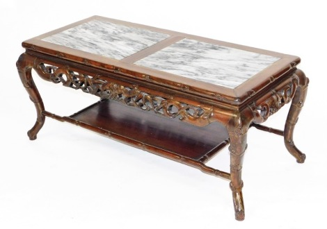 A Chinese rosewood coffee table, carved in imitation of bamboo, the rectangular top with two rectangular marble panels, carved and pierced friezes of dragons and flowers, splayed legs and lower shelf, 48cm high, 110cm wide, 45cm deep.