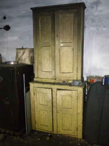A Victorian painted pine cupboard.