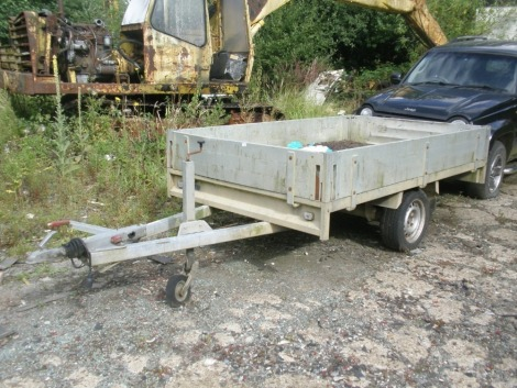 An Ansemms single axle trailer, with four drop sides.