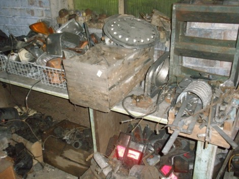A large quantity of Collectors car parts and automobilia, comprising fuel pumps, indicator, rear lenses, distributors and caps. All situated in the rear room on RHS bench and shelf unit near door.