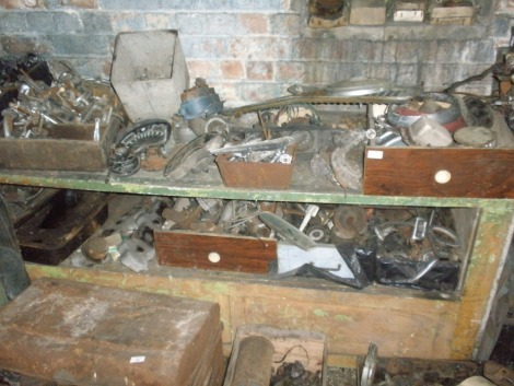 Collectors car parts and automobilia, comprising decoke sets, chrome door handles, etc. All situated in rear room on rear bench and shelf unit.