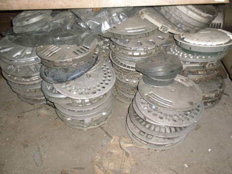 A quantity of plastic wheel trims and five engines, etc., for Montego, Ford, etc. All situated in main store far wall under middle bench.