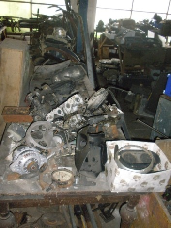A quantity of chrome bumpers and grilles for classic cars and automobilia, gearboxes plus other parts, for Vauxhall Viva, Ford Cortina, Morris Marina, etc., plus headlights units, manifolds and seven gear boxes. All situated in main store, third row on f