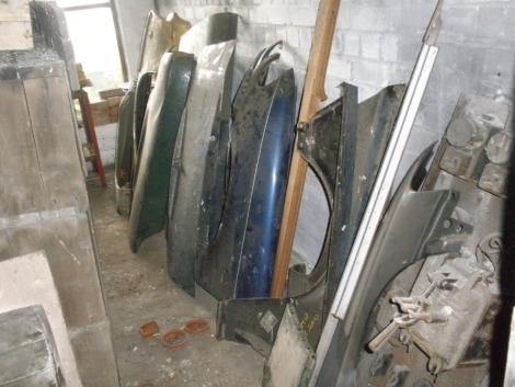 Various car body panels, comprising BMW 3 series NOS, Vauxhall Cavalier MKI, Morris Marina, Vanden Plas, etc. All situated in main store against the wall.