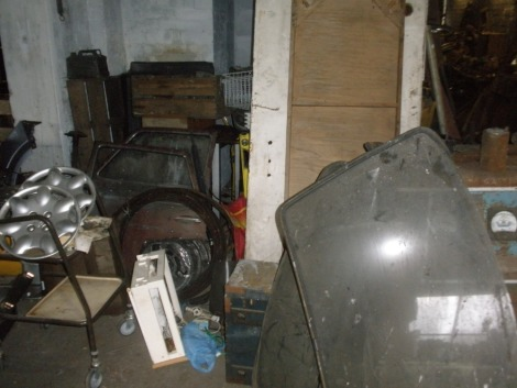 Starting handles and automobilia, etc., comprising approx one hundred starting handles, vintage battery charger, trolley tyre changer, doors, bumpers, etc., including racking. All situated in the main store in a large pile on left hand side of door to the