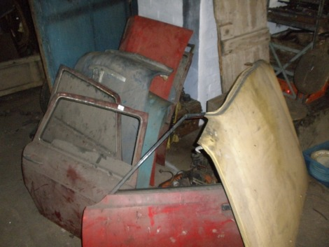 Collectors car body panels, comprising Cortina Mark III, Mercedes, Ford Escort, Austin, etc. All situated in main store in a large pile on right hand side of door to the middle store.