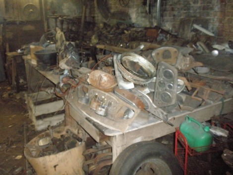 Vintage and collectors car parts and automobilia, comprising a huge quantity of dashboards and headlamps, twenty plus gearboxes, steering wheels and columns for vintage and collectors cars. All situated in middle store on U shaped benches, plus boxes and