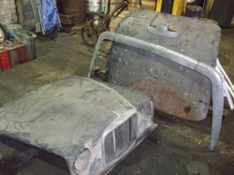 A Jaguar Mark X, comprising bonnet, boot lid and rear bumper.