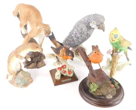 Miscellaneous ceramics, to include a Goebel grey parrot, a similar budgerigar, a Franklin Mint figure The Defender, etc.