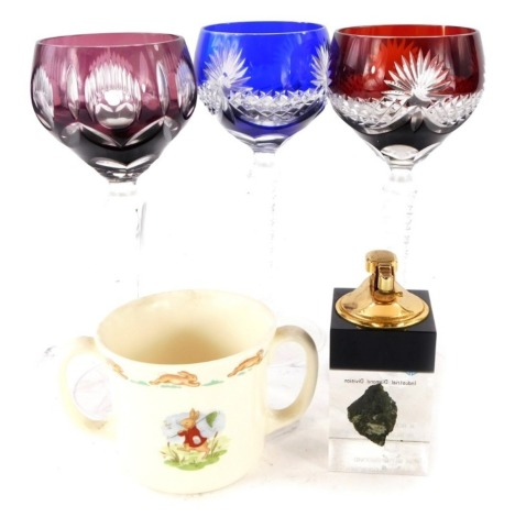 Three continental wine glasses, each with coloured bowls, a De Beers rough diamond promotional lighter, and a Bunnykins loving cup.