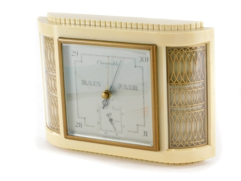 A Smiths cream and gilt Bakelite Art Deco shaped aneroid barometer, 27cm wide.