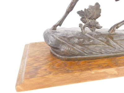 A bronzed spelter figure of a stag, indistinctly signed, 27cm wide, on associated oak plinth. - 2