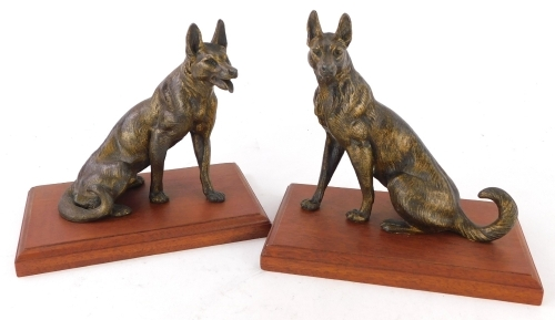 A pair of gilt spelter of Alsatians or wolves, each on a mahogany plinth, 16cm high.
