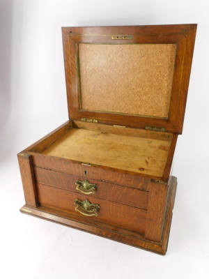 An early 20thC oak cutlery canteen, the hinged lid inset with a brass shield shaped cartouche above two drawers, 47cm wide. - 2
