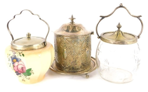 A silver plated and embossed biscuit barrel, cut glass biscuit barrel with silver plated mounts and a blush ivory biscuit barrel with silver plated mounts. (3)