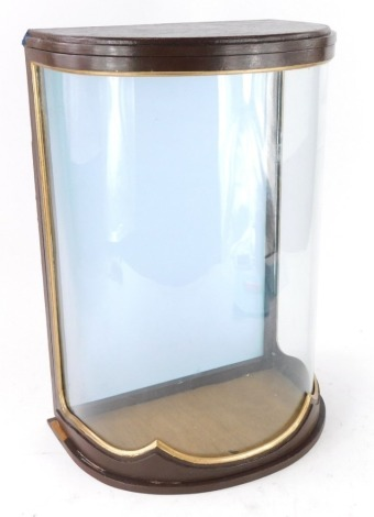 A tabletop small bowfronted display cabinet, with painted and gilt decoration, 35cm high, 31cm wide.